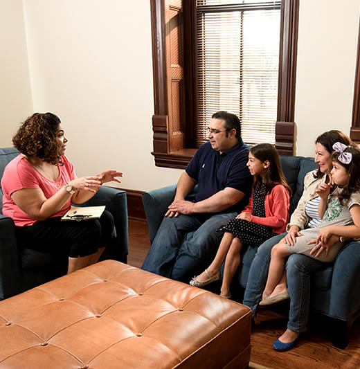 Social Work student meeting with a family